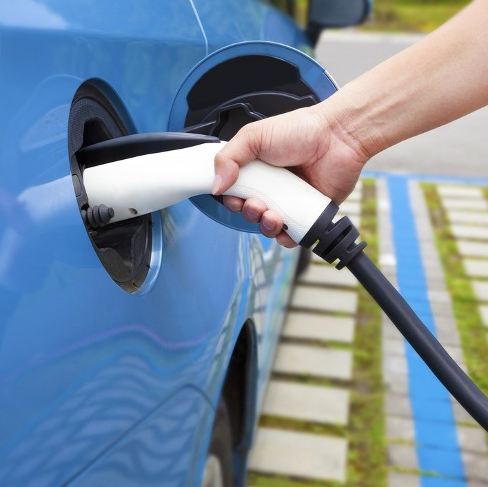Plugging in an electric vehicle to a charger
